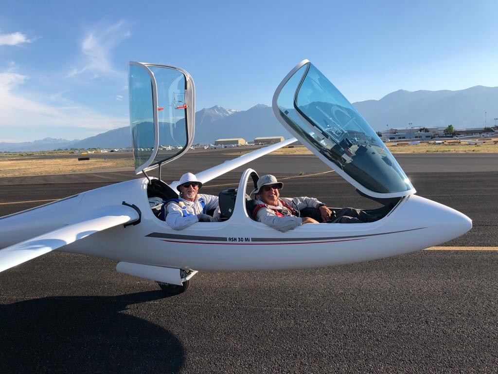Pilots Alan Coombs and Jim Payne celebrate after breaking records with Iscold's plane in Minden, Nevada, this month.